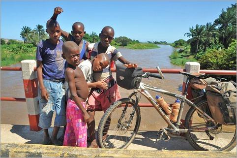 3b. Kids check out my bike, 40km south Sumbe